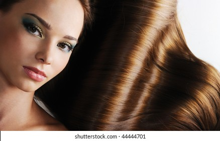Luxury of beautiful brunette long healthy female  straight hair