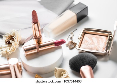 luxury beautiful light  design cosmetic makeup brand brand gold nude orange pink lipstick foundation blusher bronzer brush flower accessories white background