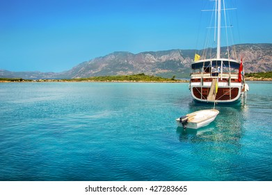 Luxury beautiful yacht in blue sea on mountain background, Mediterranean sea