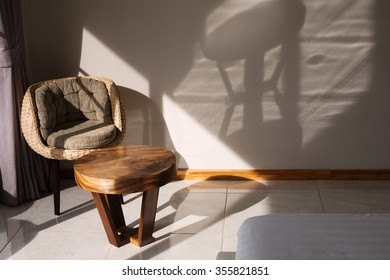 Luxury bedroom Interior design detail. Elegance chair shadows on white wall