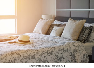 luxury bedroom interior with flower pattern pillows on bed in the morning