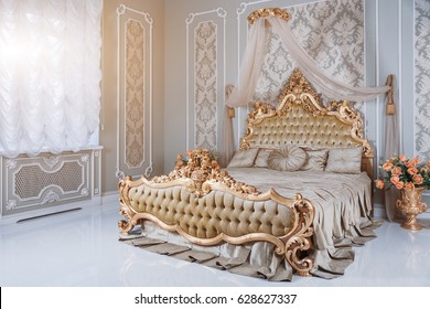 Exceptionnel Luxury Bedroom In Light Colors With Golden Furniture Details. Big  Comfortable Double Royal Bed In