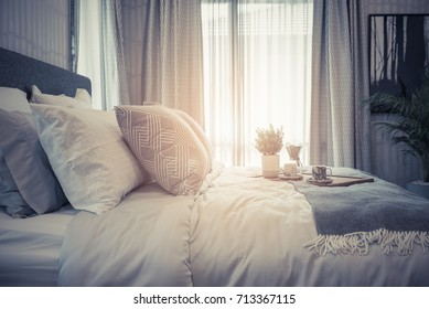 luxury bedroom style with set of pillows on king size bed, interior design concept, vintage style process