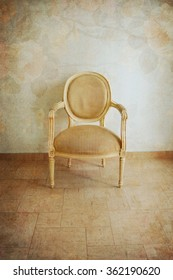 Luxury beige vintage style armchair sofa in a vintage room