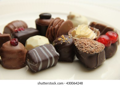 Luxury belgium chocolate pralines, decorated with fruits and nuts