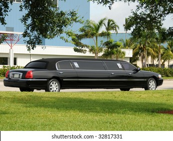 Luxury black limousine awaiting customers