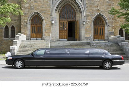 Luxury black limousine awaiting in front of a church