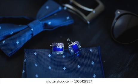 luxury blue cufflinks and tie on dark background