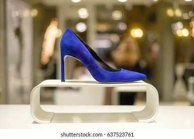 Luxury blue woman shoes on stands with blurry background