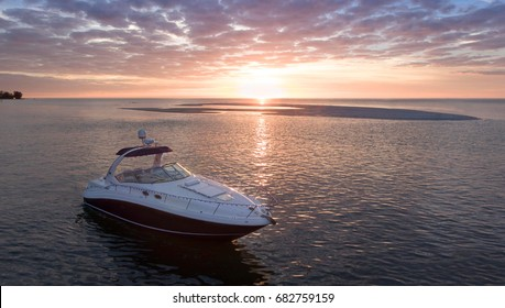 Luxury Boat  Anchored by Sandbar in Sarasota Florida during sunset