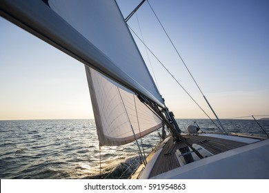 Luxury Boat Sailing In Sea During Sunset