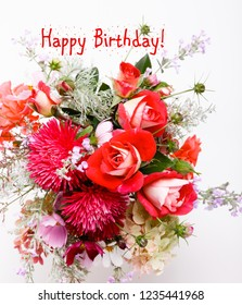 Luxury bouquet made of red roses, asters, wildflowers, cosmea, cosmos flower with, postcard with the inscription Happy Birthday