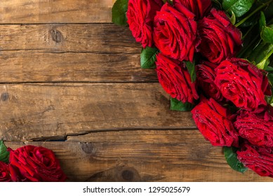 Luxury bouquet made of red roses on dark rustic background, top view, copy space
