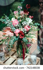 Luxury bouquet of protea, tulips and rose flowers. Bunch of fresh flowers. Bohemian