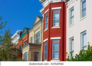Luxury brick townhouses of Washington DC, USA. Colorful residential row houses in US Capital on in spring.