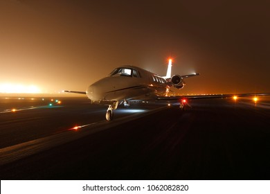 Luxury business jet ready for take off at the runway at night