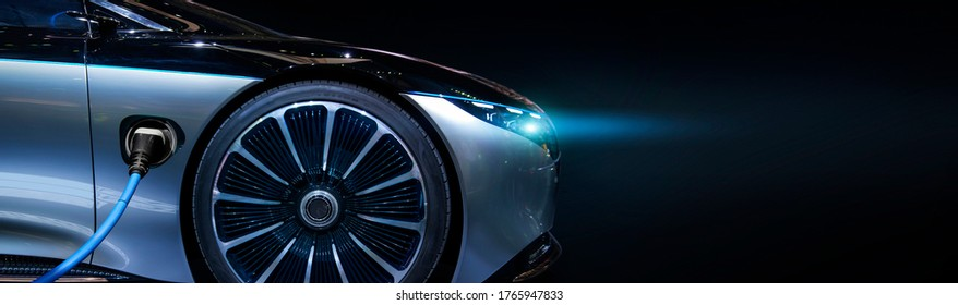 Luxury car electric car is charging. Close-up.