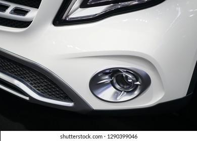 Luxury car fog light in the white luxury car.