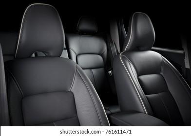 Luxury car inside. Interior of prestige modern car. Comfortable leather seats. Black perforarated leather cockpit. - Shutterstock ID 761611471