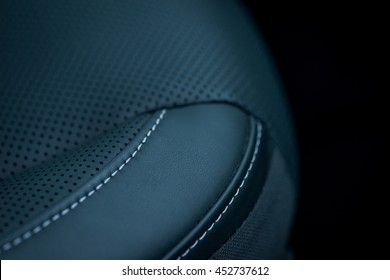 Luxury car interior details. Black leather seat
