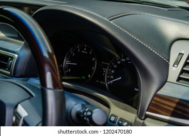 Luxury car interior details. Speedometer or Tachmeter and steering wheel,Mileage,Closeup dashboard of mileage car
