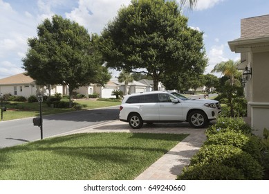 Luxury car parked on the driveway of a house in a Florida residential area, USA 2017