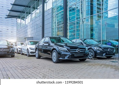 Luxury cars Mercedes-Benz C and E class parking in front of car store. Russia. Saint-Petersburg. 09 October 2018