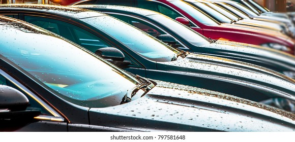luxury Cars For Sale Stock Lot Row. Car Dealer Inventory. Cars For Sale Stock Lot Row. Car Dealer Inventory. sunset sun rays light. sun beam
