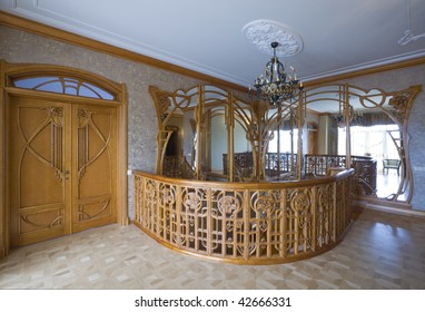 Luxury carved wood staircase and doors. Modernist style.