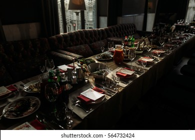 Luxury catering at restaurant wedding reception, special occasion table arrangement in brown, rustic colors, food, glasses and tableware served