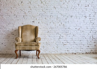 Luxury chair near white brick wall