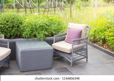 Luxury chair with piilow and table in garden