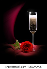 luxury champagne glass with red silk and rose on a black background
