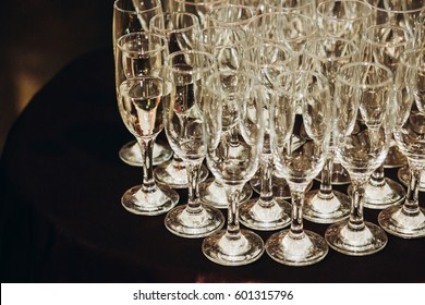 Luxury champagne glasses on table in restaurant close-up, elegant business reception party, corporate dinner party concept, expensive tableware