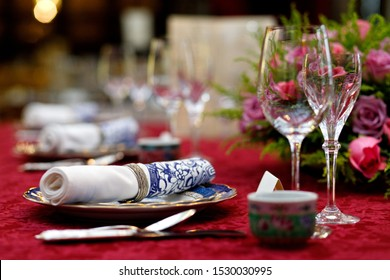 Luxury Chinese and Baba Nyonya style dinner table setting in restaurant