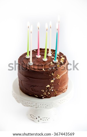 Luxury Chocolate Cake With Edible Gold Glitter On White Stand Isolated Background