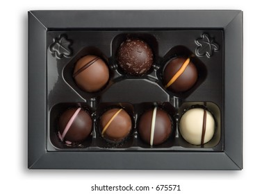 Luxury chocolates in a box, isolated against white background with clipping path