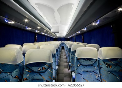 Luxury Coach interior with rows of seats and light ceiling