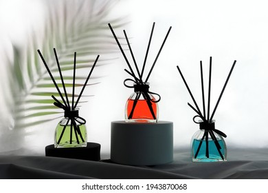 luxury colorful scent reed diffuser glass bottles are on table with table runner to creat romantic and relax ambient in the bedroom with white wall background in the morning for happy valentine day