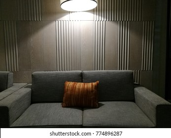 Luxury comfortable sofa bed furniture with empty background and light shine on the object good for interior design