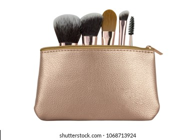 Luxury cosmetic travel bag with essential kit of brushes for make-up, beauty products isolated on white background, clipping paths included