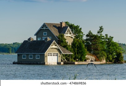 Luxury cottage and a boathouse on a rocky island