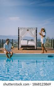 Luxury country house with swimming pool in Italy. Pool and old farm house during sunset central Italy. Couple on Vacation at luxury villa in Italy, men and woman watching sunset