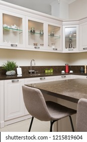 Luxury cozy modern light beige kitchen, embedded microwave and electric oven, gas stove, minimalistic clean design