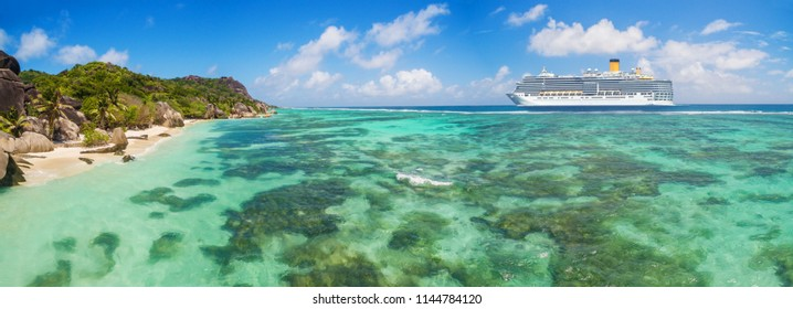 Luxury cruise boat with tropical Seychelles island. Concept of long-distance cruise among the continents.