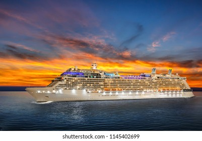 Luxury cruise ship sailing to port on sunset.