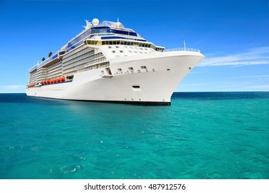 Luxury cruise ship sailing to port on sunny day