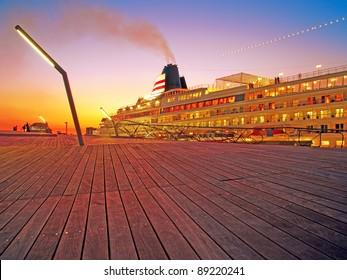 Luxury cruise ship at Yokohama Osanbashi Pier in Yokohama, Japan at twilight.