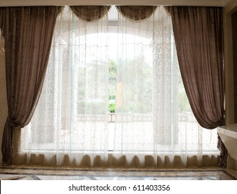 Luxury curtains with a copy-space in the middle.