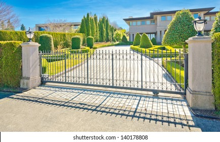 A luxury custom made house behind the gates in suburbs of Vancouver, Canada.
